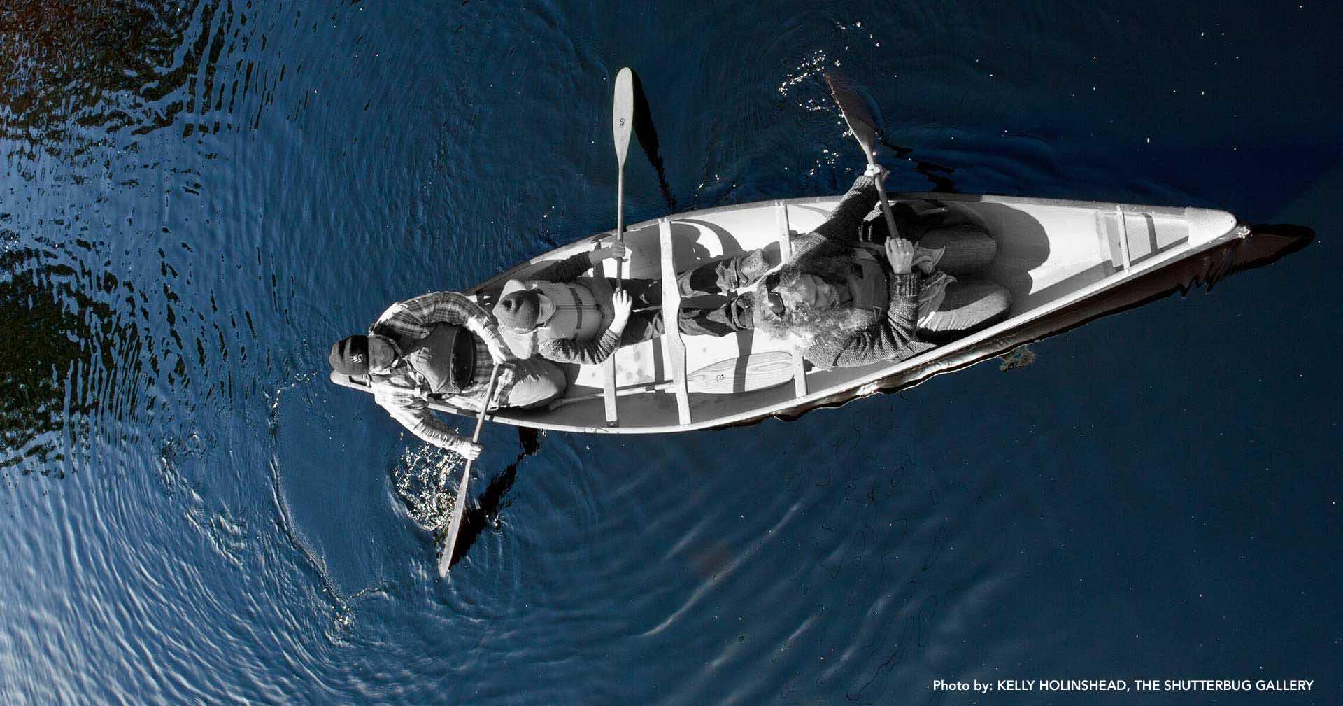 Overhead shot of family paddling a canoe